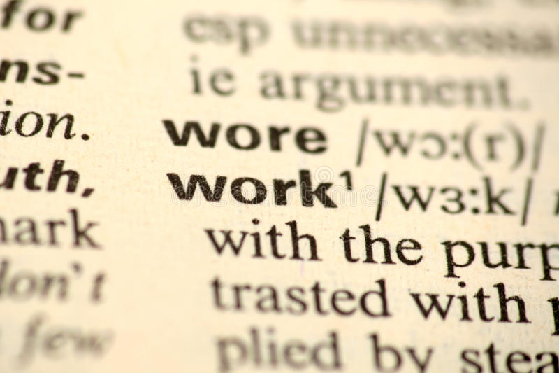 Ordarbete i en ordbok arkivfoto