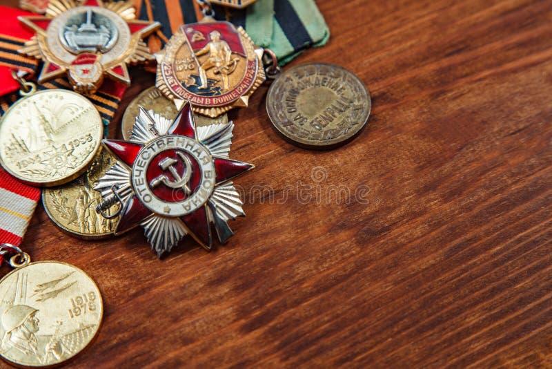 Orden de la guerra patriótica en el St y las medallas para la victoria sobre Alemania Imagen del foco selectivo imagen de archivo libre de regalías