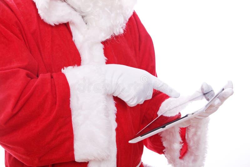 Ordenador digital de la tablilla de Papá Noel fotos de archivo libres de regalías