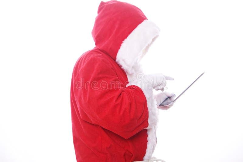 Ordenador digital de la tablilla de Papá Noel foto de archivo libre de regalías
