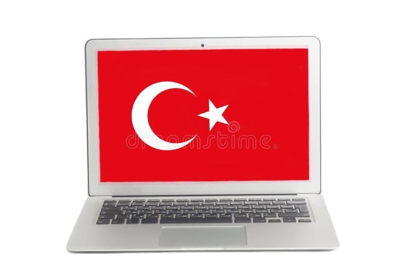 Ordenador portátil con la bandera turca en la pantalla fotografía de archivo