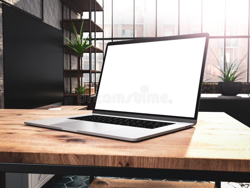 Ordenador portátil con la plantilla de la maqueta de la pantalla en blanco en la tabla en viejo interior industrial del desván de imágenes de archivo libres de regalías