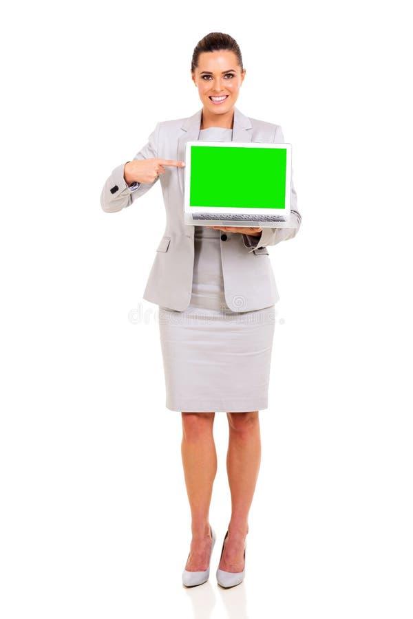 Ordenador portátil de la mujer de negocios imagen de archivo libre de regalías
