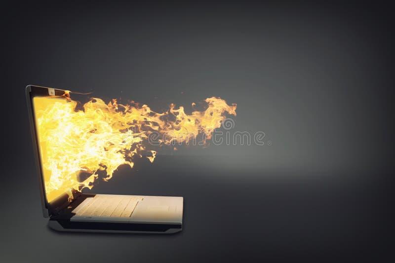 Ordenador portátil en el fuego fotos de archivo libres de regalías