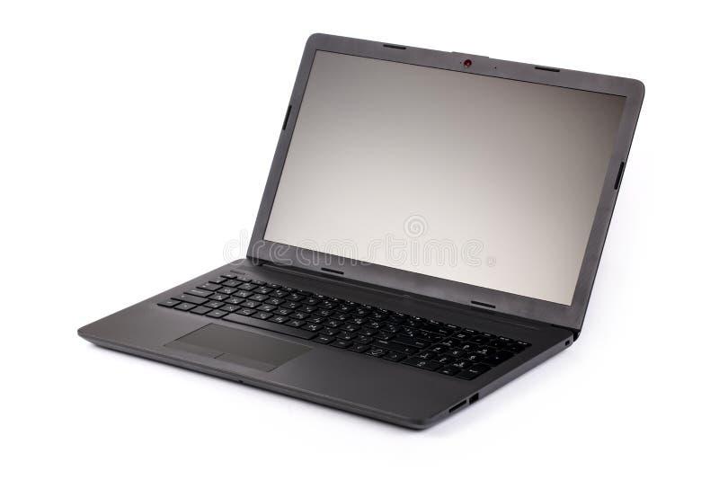 Ordenador portátil gris abierto en un fondo blanco fotos de archivo