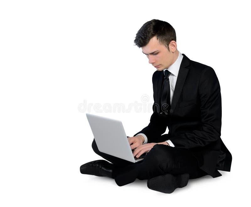 Ordenador portátil que mecanografía del hombre de negocios imagen de archivo
