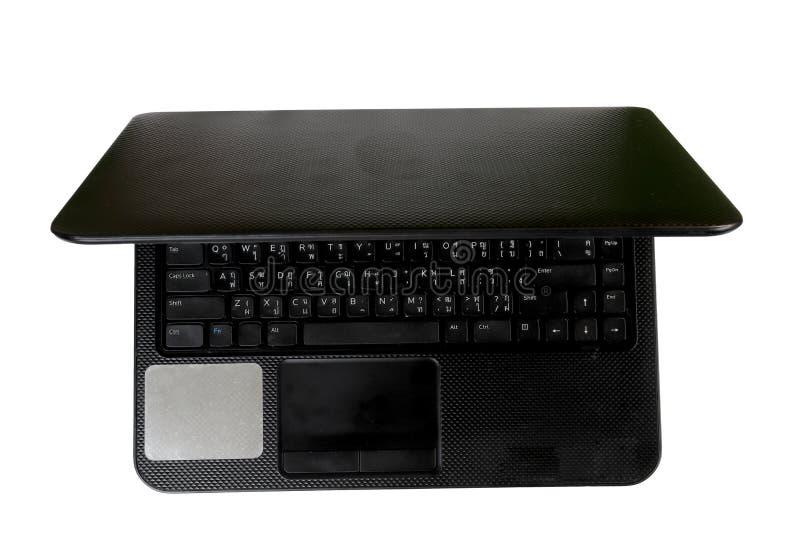Ordenador port?til con el espacio vac?o, ordenador port?til negro, teclado tailand?s, aislado en el fondo blanco imagenes de archivo