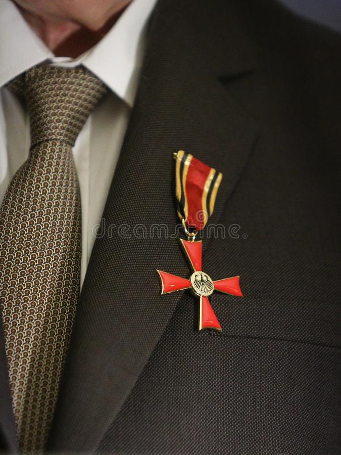 Order of Merit of the Federal Republic of Germany. Details of a man holding a cross of Order of Merit of the Federal Republic of Germany during a speech royalty free stock photos