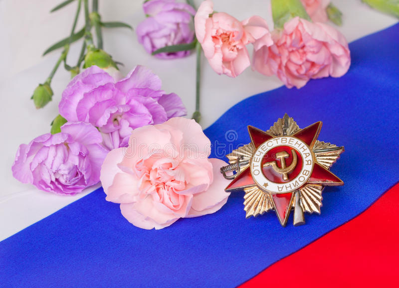 Order Of The Patriotic War With Pink Carnations Stock Photo