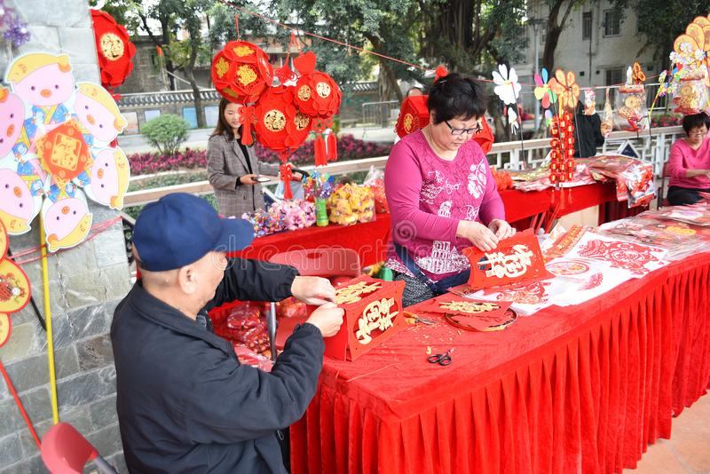 In order to celebrate the Chinese New Year, Chinese folk artists are making lanterns in paper royalty free stock photo