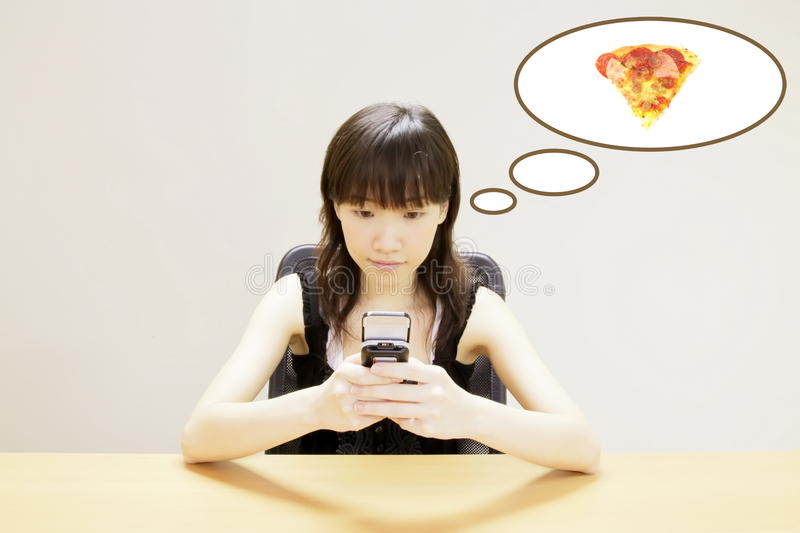 Ordering Pizza. Young Asian Ordering or Calling Pizza Delivery royalty free stock images