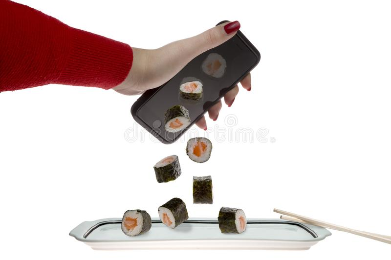 Ordering sushi with a smartphone. Ordering sushi online with a smartphone on a white background stock photography