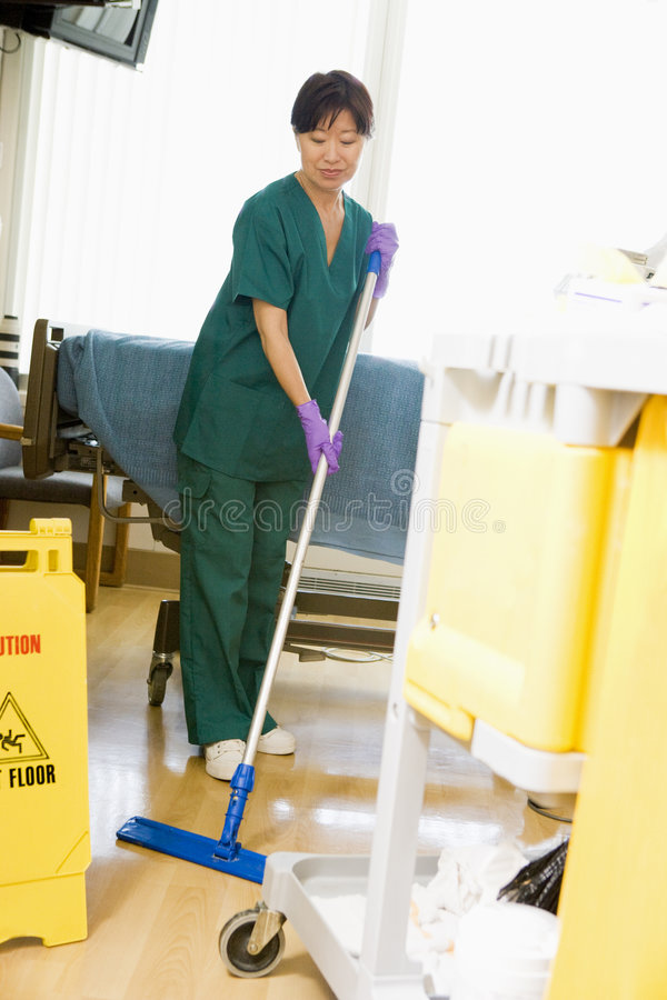 An Orderly Mopping The Floor In A Hospital Stock Image Image Of