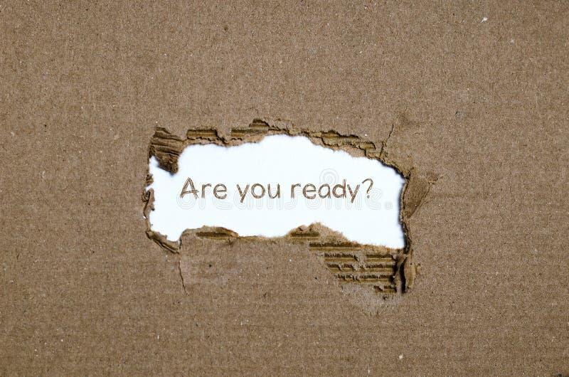 Ordet är dig ordnar till att synas bak sönderrivet papper arkivbild