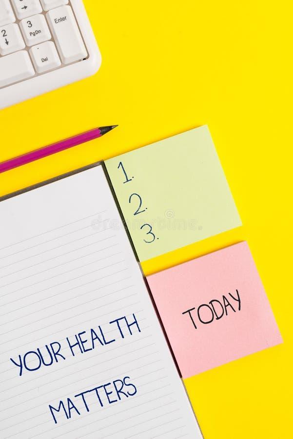Ordhandstiltext dina h?lsofr?gor Affärsidéen för goda hälsor är viktigast bland annat royaltyfria foton