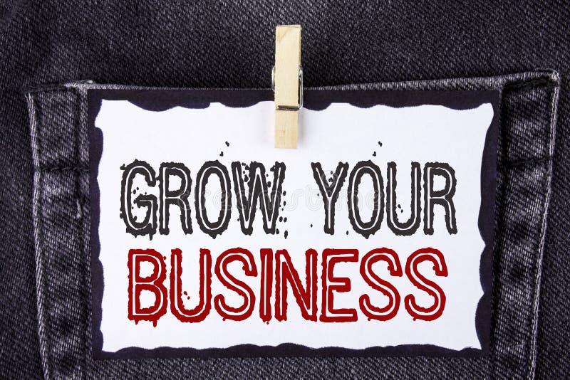 Ordhandstiltext växer din affär Affärsidéen för förbättrar ditt arbete förstorar betagna konkurrenter för företaget som är skrift royaltyfria bilder
