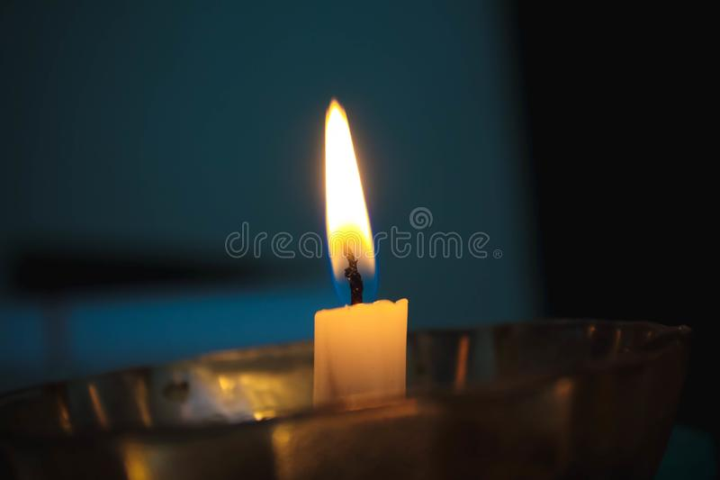 Ordinary candle light. `A candle is an ignitable wick embedded in wax, or another flammable solid substance such as tallow, that provides light, and in some royalty free stock images