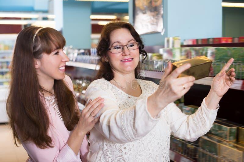 Ordinary female buyers selecting tea stock image