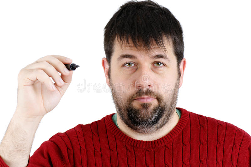 Ordinary guy with pen ready. Ordinary guy, regular joe, ready to write something with his big black felt pen, real candid person stock image