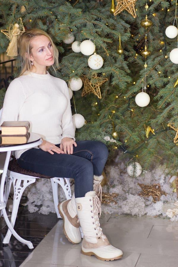 Ordinary long hair female celebration Christmas. Ordinary blonde long hair female celebration Christmas stock photography