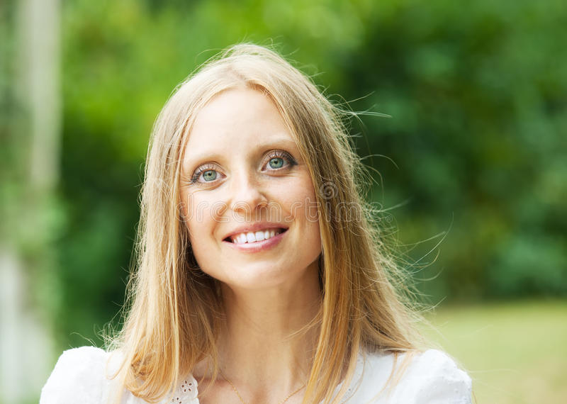 Ordinary middle-aged woman. Against nature background stock image
