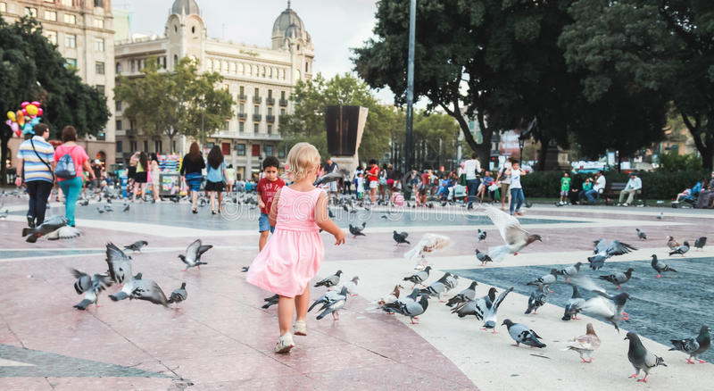 Ordinary people and doves, Barcelona. Barcelona, Spain - August 25, 2014: Ordinary people and doves are on placa de Catalunya in Barcelona royalty free stock photo