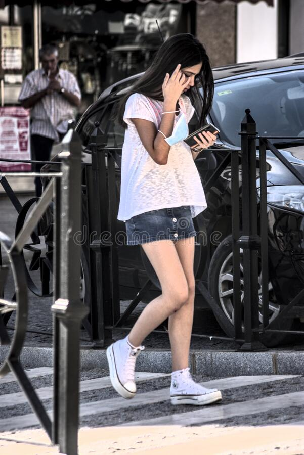 Young lady walking in the street. Urban photography royalty free stock image