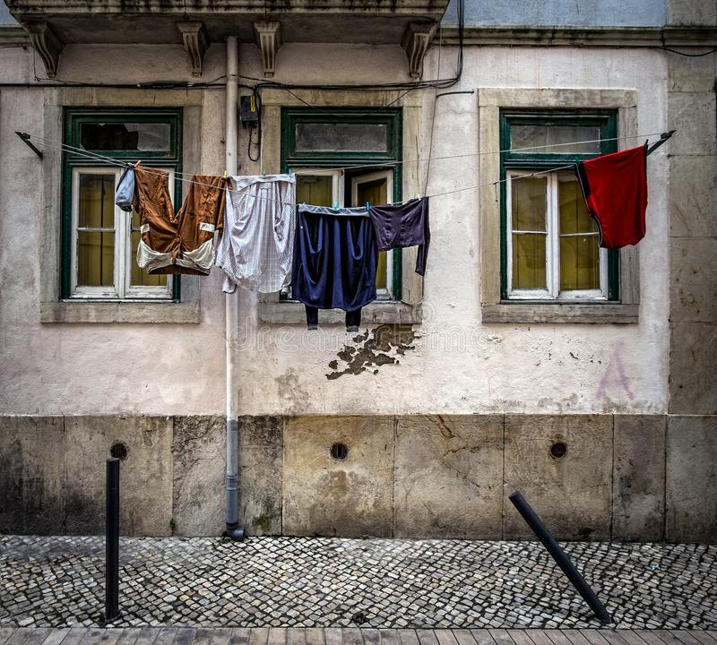 Ordinary stories of the old Lisbon. Portugal. The linen was dried on a rope. The usual life of the old Lisbon. Alfama district. Portuguese classics. On the way royalty free stock images