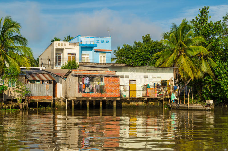Ordinary Vietnamese riverside home in Can Tho, Vietnam royalty free stock photo