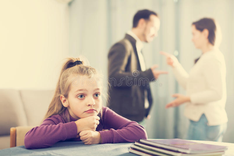 Ordinary woman and man arguing with each other. Ordinary women and men arguing with each other while their daughter at home royalty free stock photos