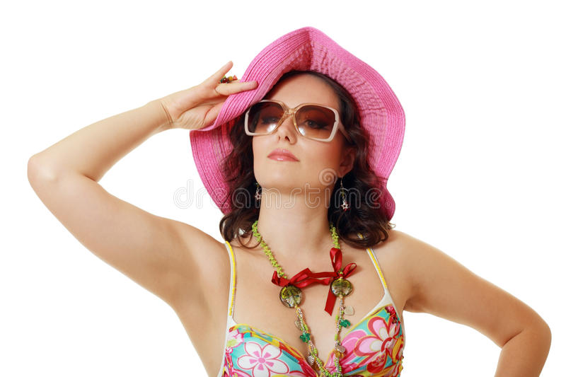 Ordinary woman in swimsuit. Sunglasses and pink hat on white background stock image