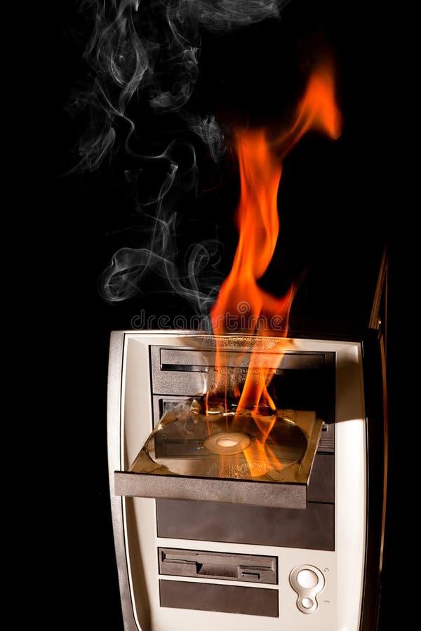 Ordinateur brûlant photographie stock