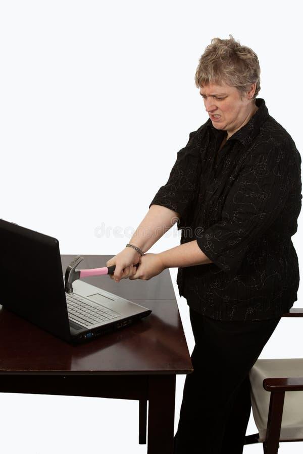 Ordinateur de fixation de femme photo libre de droits