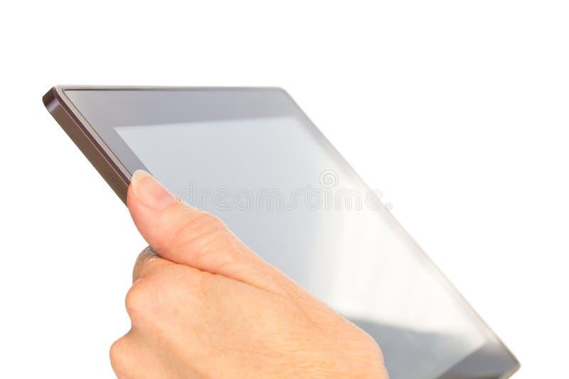 Ordinateur de tablette de fixation de main d'isolement sur le blanc photographie stock