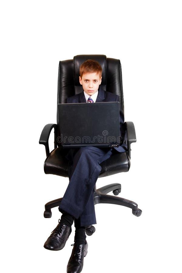 ordinateur portatif d'enfant d'affaires utilisant des jeunes image stock