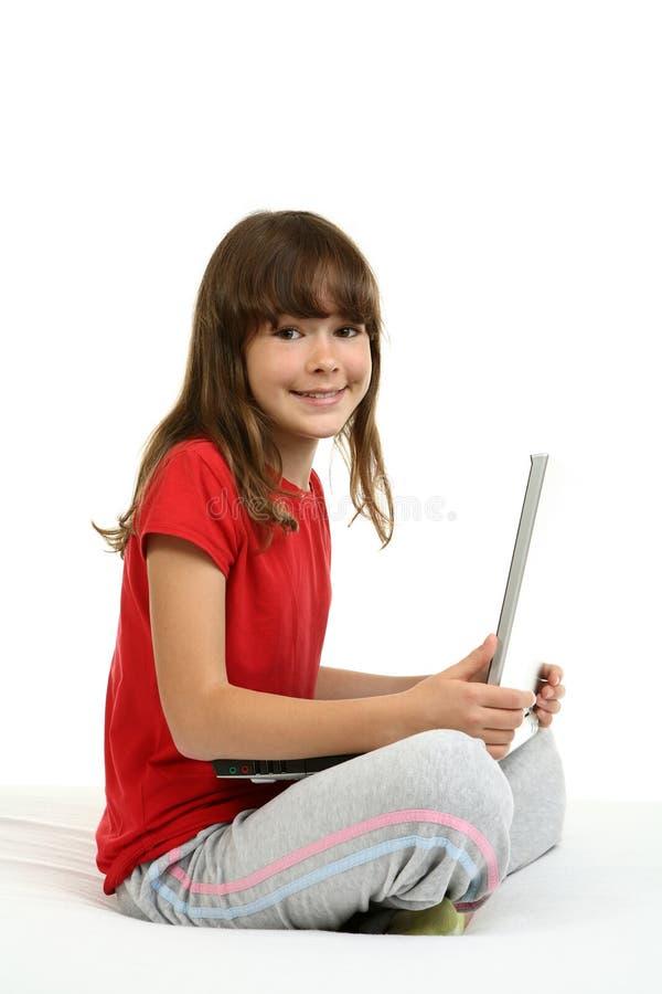 ordinateur portatif de fille photographie stock libre de droits