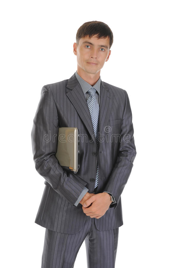 Ordinateur portatif de fixation d'homme d'affaires image stock
