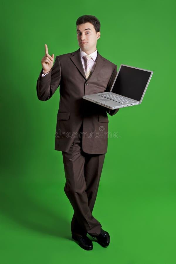 Ordinateur portatif de fixation d'homme d'affaires image libre de droits