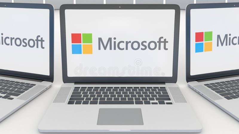 Ordinateurs portables avec le logo de Microsoft sur l'écran Rendu conceptuel de l'éditorial 3D d'informatique illustration libre de droits