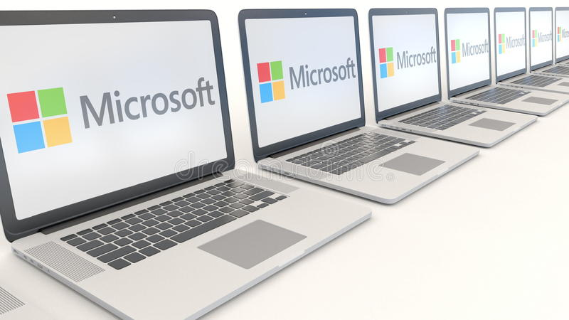 Ordinateurs portables modernes avec le logo de Microsoft Rendu conceptuel de l'éditorial 3D d'informatique illustration libre de droits