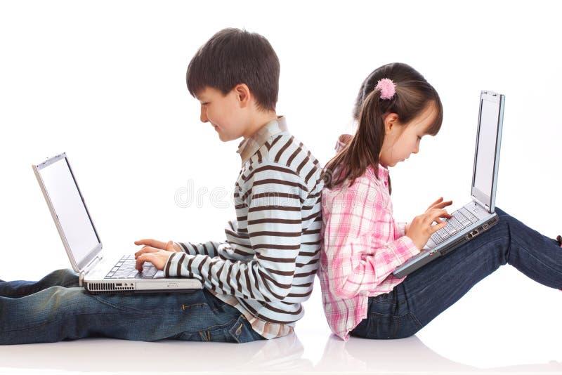 ordinateurs portatifs d'enfants images libres de droits