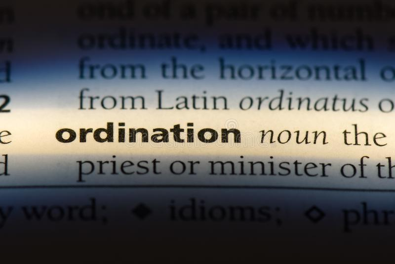 Ordination. Word in a dictionary.  concept stock photos