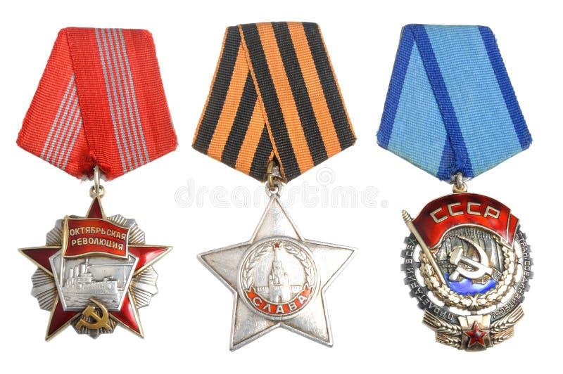 Ordini e premi sovietici su bianco immagine stock