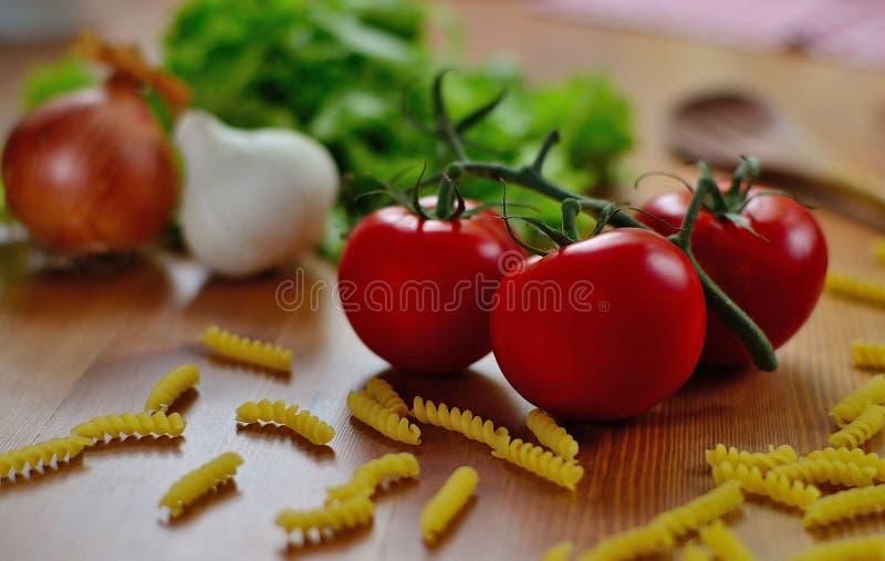Ordnad tomat royaltyfria bilder