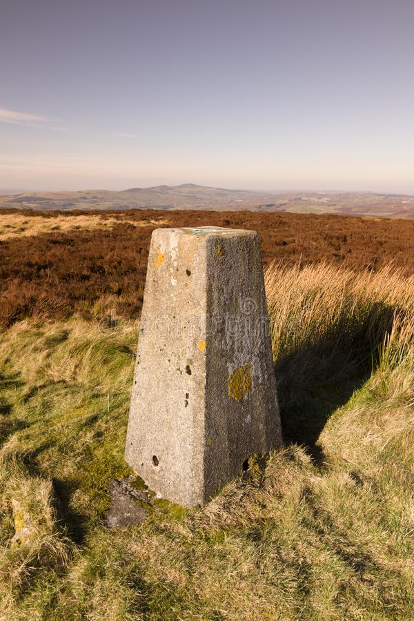 Ordnance Survey Trig Pillar. Ordnance Survey triangulation point or pillar on the summit of Cyrn y Brain North Wales. Built in the 1930s and used for mapping and royalty free stock images