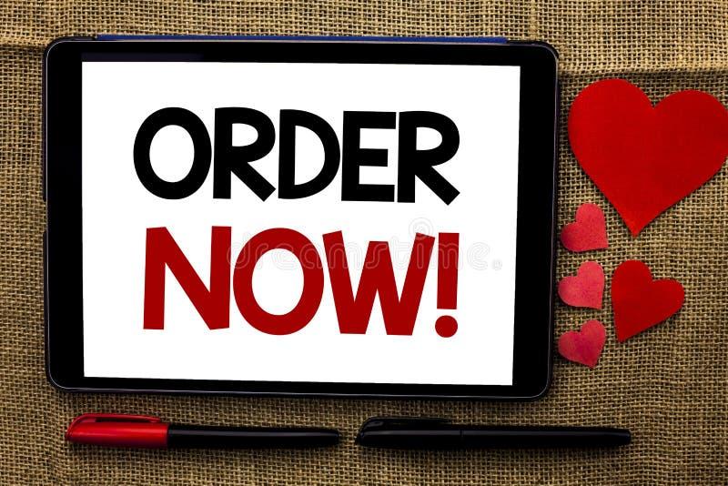 Ordre d'écriture des textes d'écriture maintenant S'inscrire de produit de boutique de promotion des ventes d'affaire d'ordre d'a photo stock