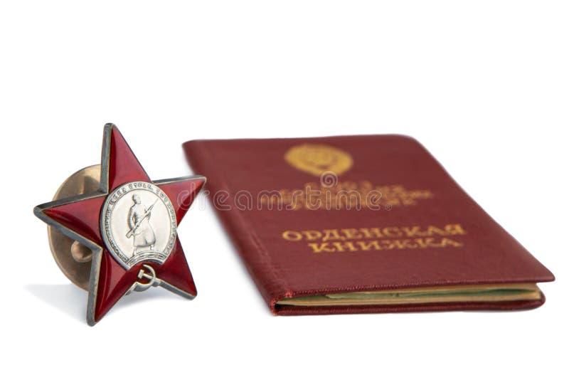 Ordre de Red Star et de carnet de commandes sur un fond blanc Récompenses de l'Union Soviétique Articles d'isolement photographie stock libre de droits