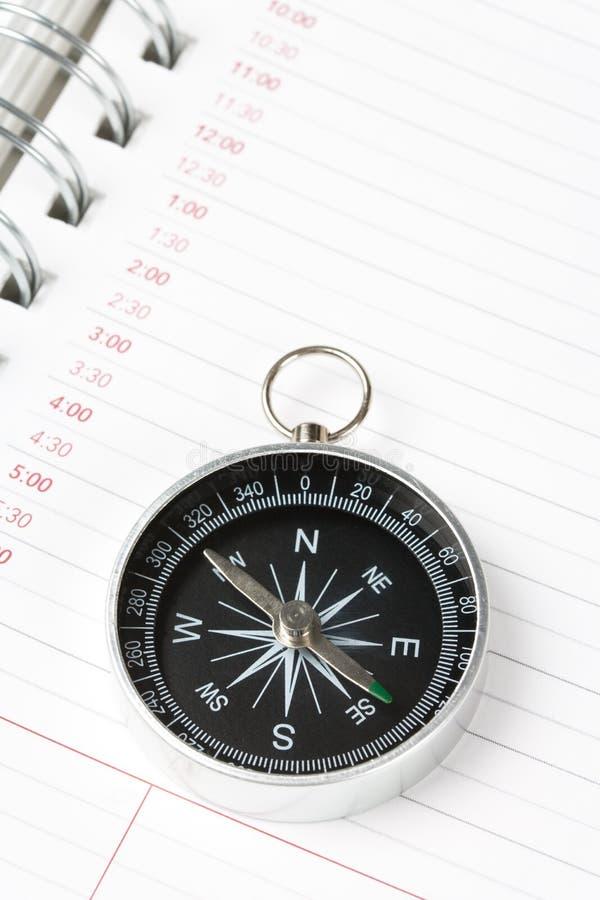 Ordre du jour et compas de calendrier photographie stock