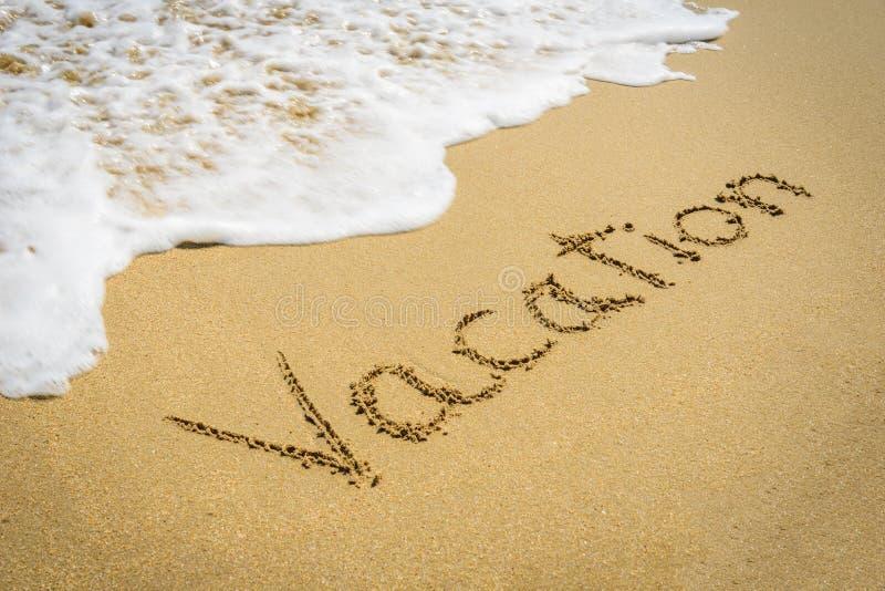 Ordsemester på strandsanden arkivfoto
