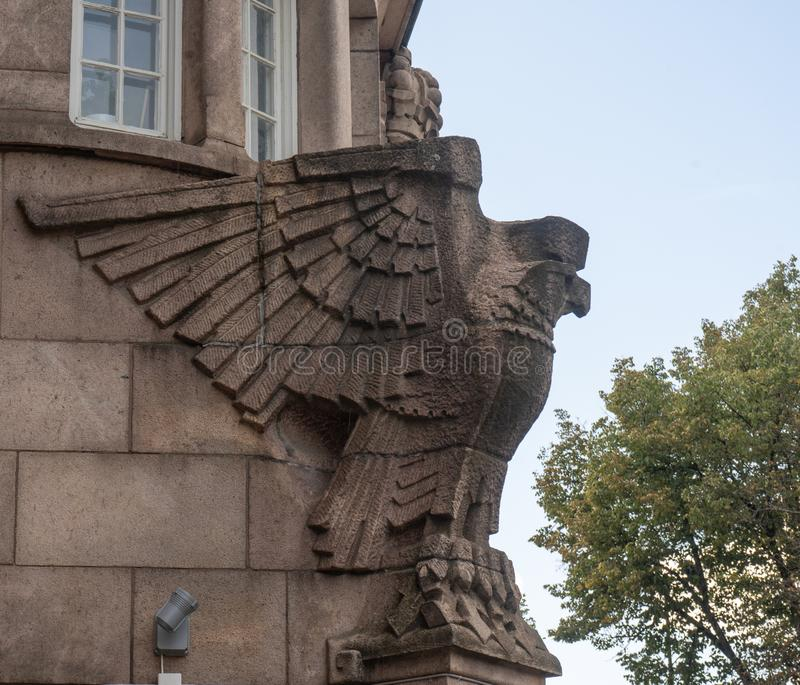 Eagle Sculpture. A fragment of a building. stock photography